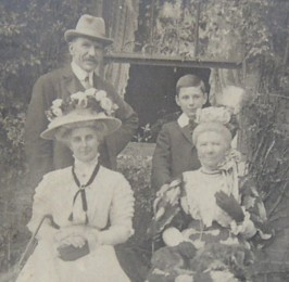 Frederick Crofton Heath-Caldwell with his son Martin, wife Constance and aunt Henrietta Helsham-Jones outside Vigo, Holmwood early 1900s. Click for larger image.